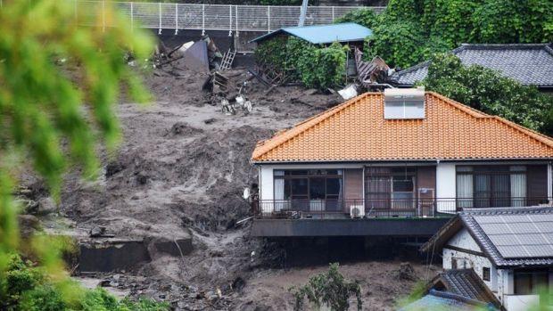 Homes destroyed by mudslide triggered by torrential rain in Atami, Japan.