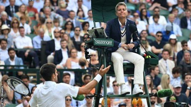 Novak Djokovic talks to umpire Marija Cicak