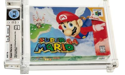A Super Mario 64 cartridge sealed in a plastic case with annotated grading info