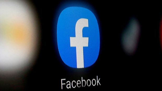 The Facebook logo seen in close-up from a smartphone