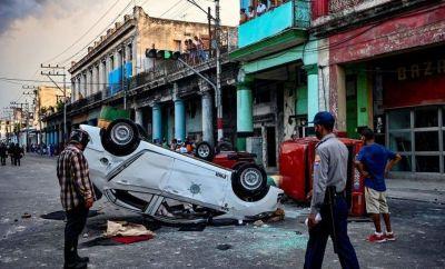 Cars turned upside down by demonstrators amid unrest in Cuba, July 2021
