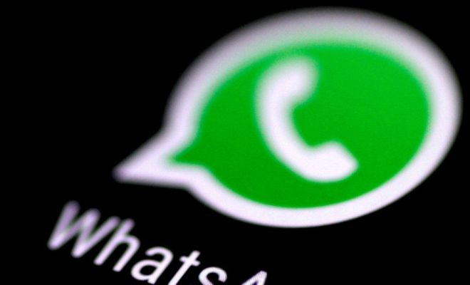 WhatsApp logo in close-up from a phone screen