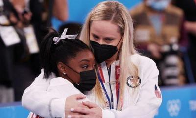 Simone Biles and United States coach Cecile Landi
