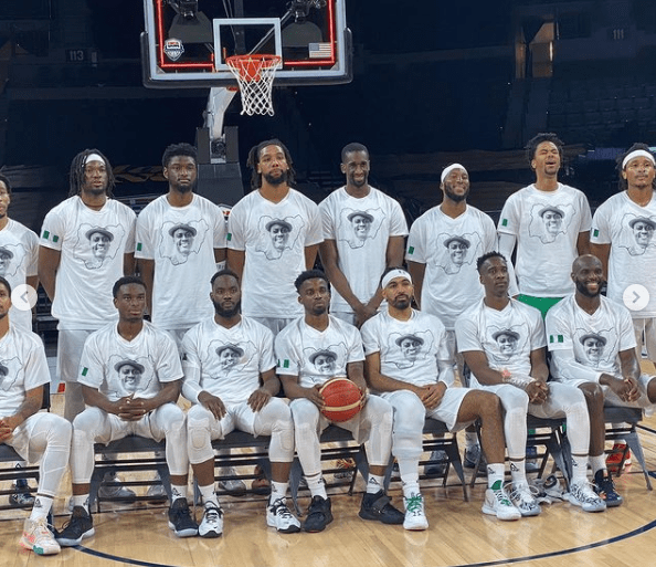 Nigerian Basketball team honor Sound Sultan with a warmup shirt that has his face before their pre-Olympics match against Australia (video)