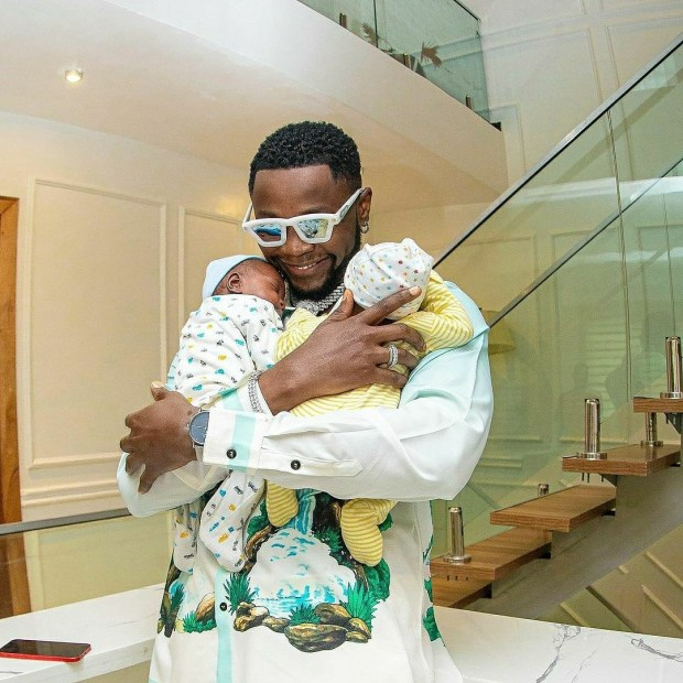 Kizz Daniel reveals he welcomed triplets but lost one as he gifts his newborn sons luxury apartments each (photos)