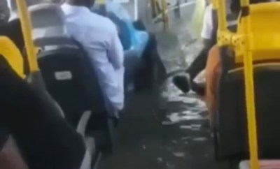 BRT bus floods with passengers in it following heavy downpour in Lagos (videos/photos)