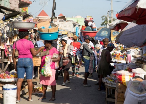 People walk in a market as they go about their lives in Port-au-Prince, Haiti, May 24, 2021