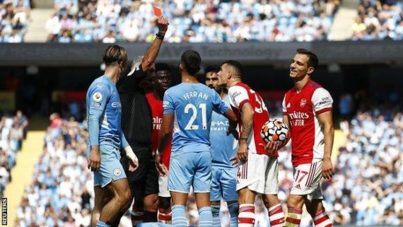 Granit Xhaka is shown a straight red card