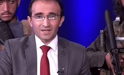 Terrified Afghan TV presenter reads the news while surrounded by gun-toting Talibans (video)