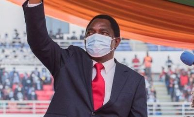 Newly elected Zambia President Hakainde Hichilema waves at the crowd after taking oath of office at the Heroes Stadium in Lusaka on August 24, 2021.