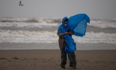 A local resident as she tries to take photos ahead of the arrival of Storm Nicholas in Texas