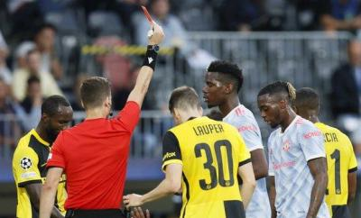 Aaron Wan-Bissaka is shown the red card during Manchester United's Champions League group game against Young Boys