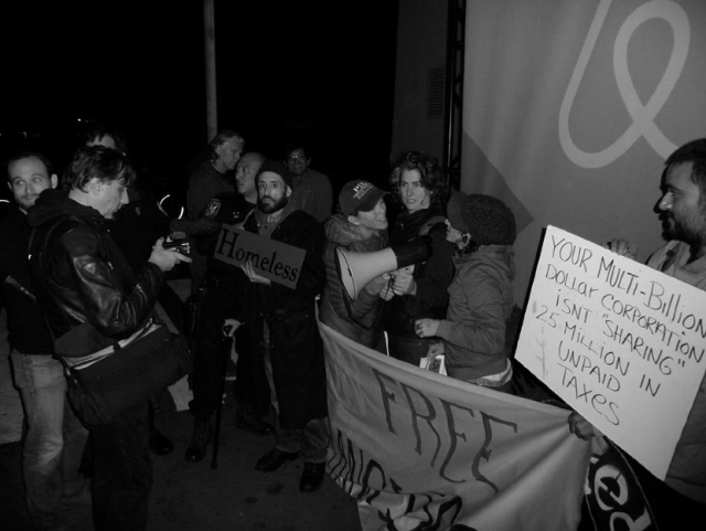 Anti-eviction protesters gather at an Airbnb conference