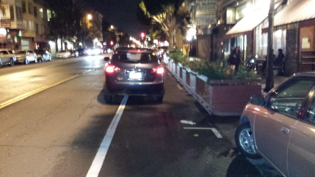 Uber driver blocks the bike lane on Valencia