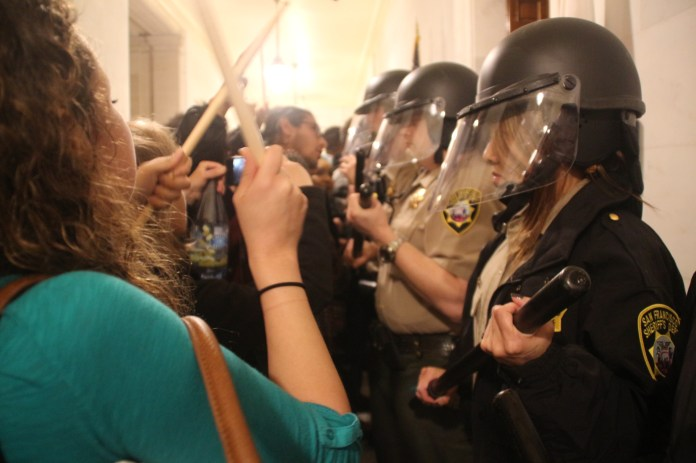 Protestors and police face off