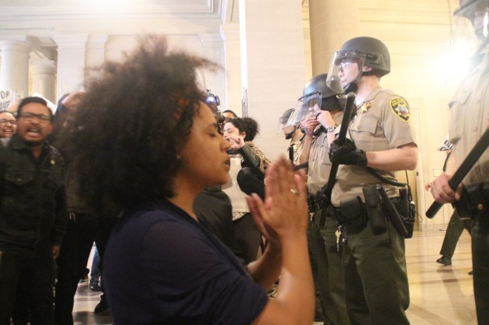 Protestor Prays for an End to Police Violence
