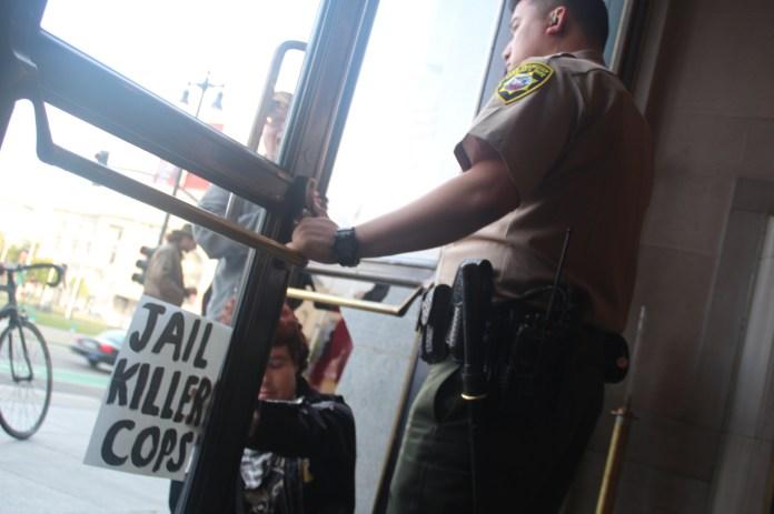Protestor Holds City Hall Door Open