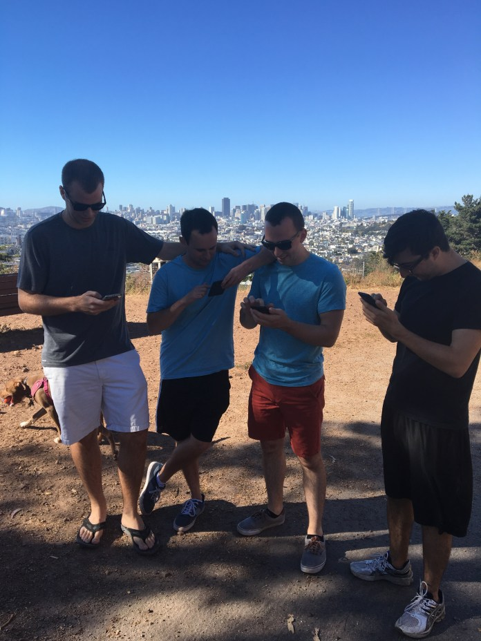 Casey, Evan, Pat, and Nick can barely stop their Pokemon search to talk to a reporter