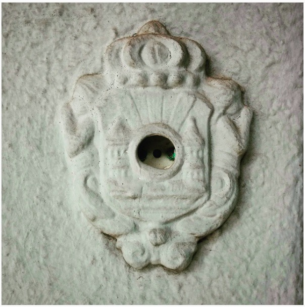 "The ornate, broken doorbell outside Weidenbaum's home. ""The vestigial doorbell. The doorbell emeritus."""