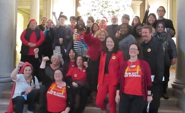 Supporters of Free City College celebrate after a 9-1 vote