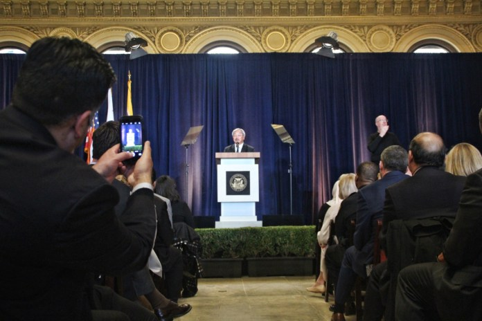 """Today, we stand in beautiful Hibernia Bank building, celebrating a resurgence of San Francisco's grand boulevard. Dozens of new businesses, arts organisations and large employers have brought new life to Market Street and the Tenderloin,"" Mayor Lee said to a packed room. Photo by Sana Saleem."
