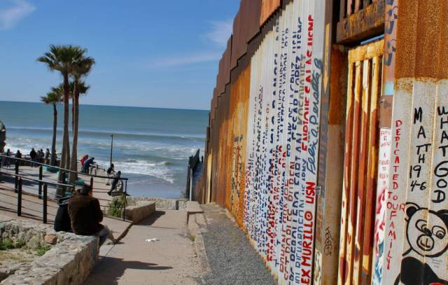 Names of veterans who fought in the United States army and who were later deported from the country are written along the border wall at the shuttered Friendship Park. Photo by Matthew Suárez