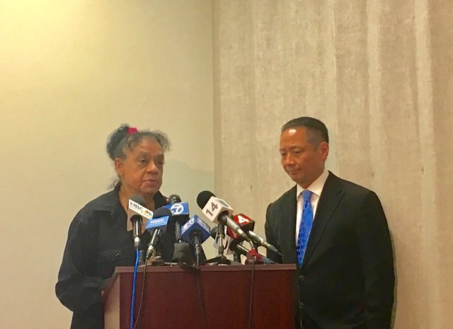 Sean Moore's mother, Cleo Moore, stands with Public Defender Jeff Adachi