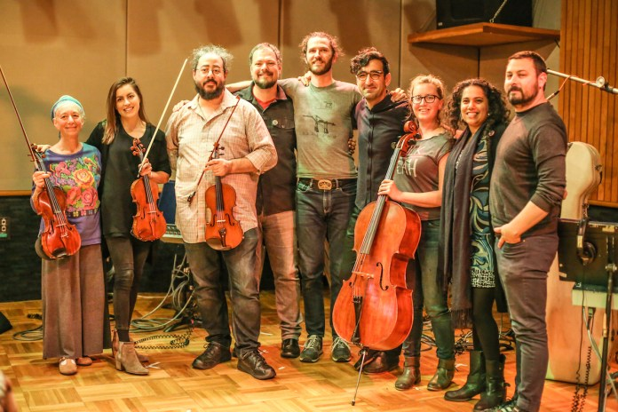 Lyz Luke, Joe Bagale, Sahba Aminikia, and Awesome Orchestra post-recording. Photo by Cristina Isabel Rivera.