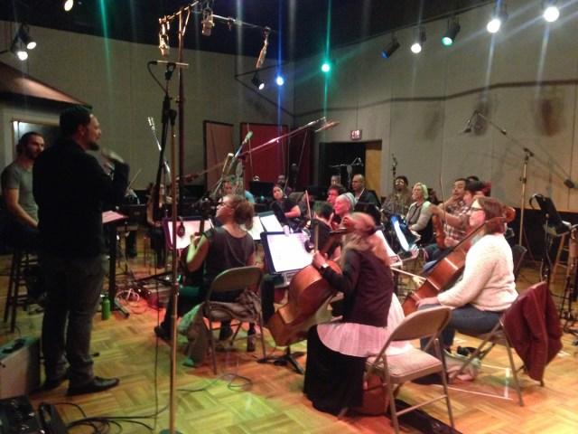 "Joe Bagale discussing his arrangement of ""A Day in the Life"" with members of Awesome Orchestra. Photo by Joanna Ladd."
