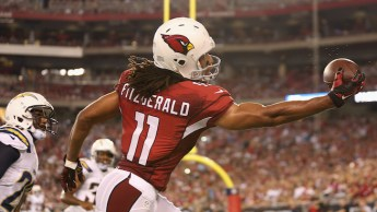GLENDALE, AZ - SEPTEMBER 08: Wide receiver Larry Fitzgerald #11 of the Arizona Cardinals attempts to catch a pass during the NFL game against the San Diego Chargers at the University of Phoenix Stadium on September 8, 2014 in Glendale, Arizona. The Cardinals defeated the Chargers 18-17. (Photo by Christian Petersen/Getty Images)