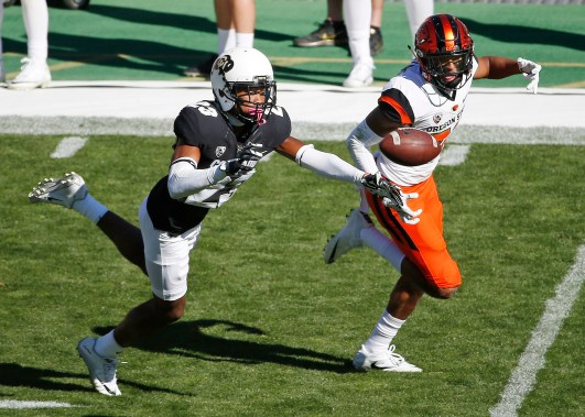 Colorado defensive back Ahkello Witherspoon (23) blocks a pass to Oregon State wide receiver Seth Collins (22) during the second half of an NCAA college football game in Boulder, Colo., Saturday, Oct. 1, 2016. Colorado won, 47-6. (AP Photo/Brennan Linsley)