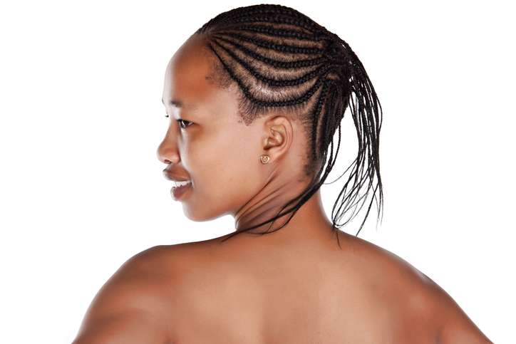 portrait of an young African with braids, isolated on white