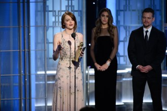 """Emma Stone accepts the Golden Globe Award for BEST PERFORMANCE BY AN ACTRESS IN A MOTION PICTURE – COMEDY OR MUSICAL for her role in """"La La Land"""" at the 74th Annual Golden Globe Awards at the Beverly Hilton in Beverly Hills, CA on Sunday, January 8, 2017."""