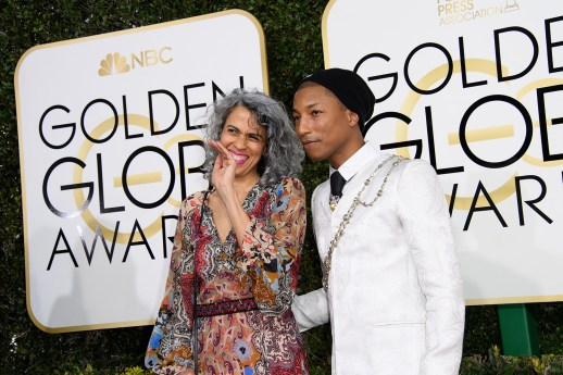 Musician Pharrell Williams (R) and Helen Lasichanh attend the 74th Annual Golden Globe Awards at the Beverly Hilton in Beverly Hills, CA on Sunday, January 8, 2017.
