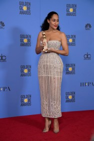 """After winning the category of BEST PERFORMANCE BY AN ACTRESS IN A TELEVISION SERIES – COMEDY OR MUSICAL for her role in """"Black-ish,"""" actress Tracee Ellis Ross poses backstage in the press room with her Golden Globe Award at the 74th Annual Golden Globe Awards at the Beverly Hilton in Beverly Hills, CA on Sunday, January 8, 2017."""