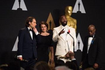 "Jeremy Kleiner, Adele Romanski, Tarell Alvin McCraney and Barry Jenkins pose backstage with the Oscar® for Best motion picture of the year and for Best Adapted screenplay, for work on ""Moonlight"" during the live ABC Telecast of The 89th Oscars® at the Dolby® Theatre in Hollywood, CA on Sunday, February 26, 2017."