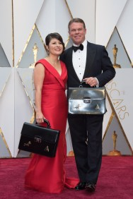 Pricewaterhouse Cooper representatives arrive on the red carpet of The 89th Oscars® at the Dolby® Theatre in Hollywood, CA on Sunday, February 26, 2017.