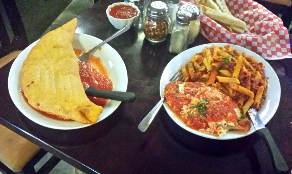Deep-fried panzerotti and chicken parmesan with penne bolognese.