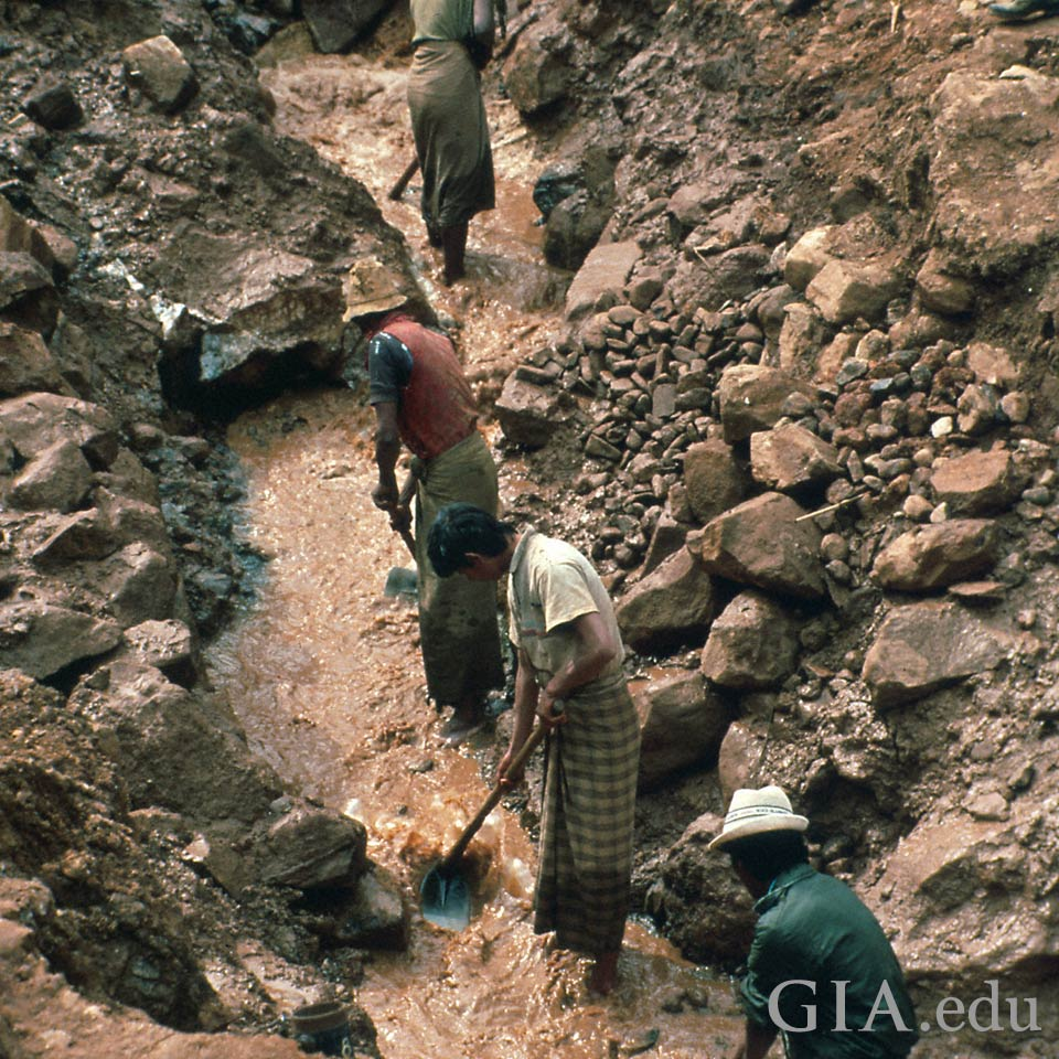 Miners outside of Sapphire mine in Mogok