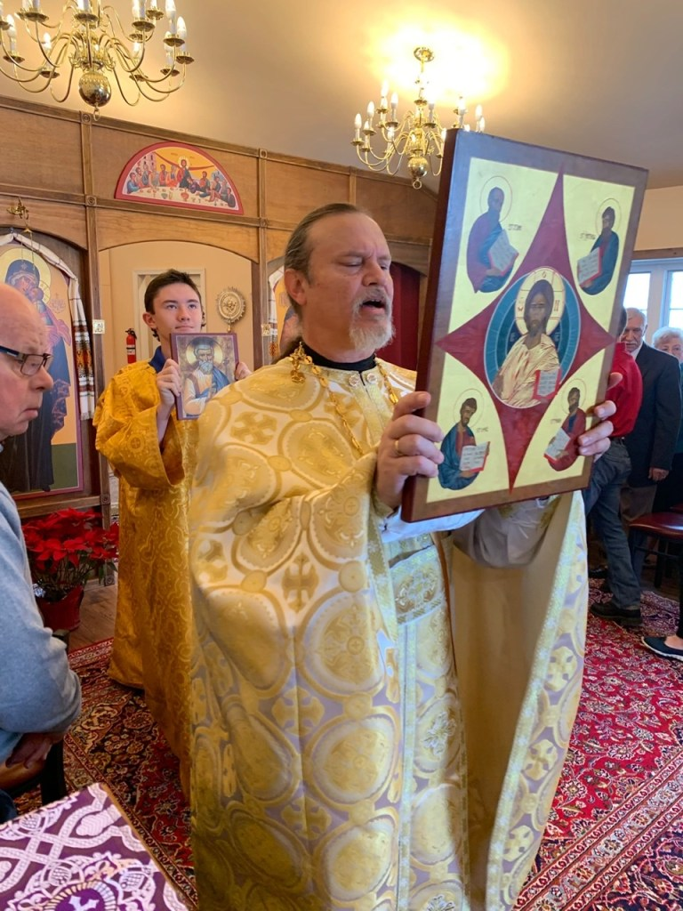 Fr. Gregory with icon of Jesus and the Four Holy Evangelists, patrons of our Church