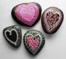 A variety of hearts on river rocks