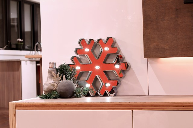 Dreamhouse Project Christmas home tour: industrial snowflake marquee