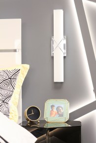 Kichler Trinsic LED Light in Chrome installed vertically next to Kash's bed