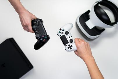 person-holding-white-and-black-xbox-one-game-controller