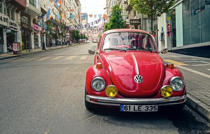 red-volkswagen-beetle-parked