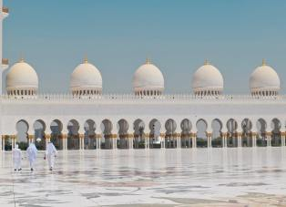 three-men-walking-in-front-of-a-dome-building