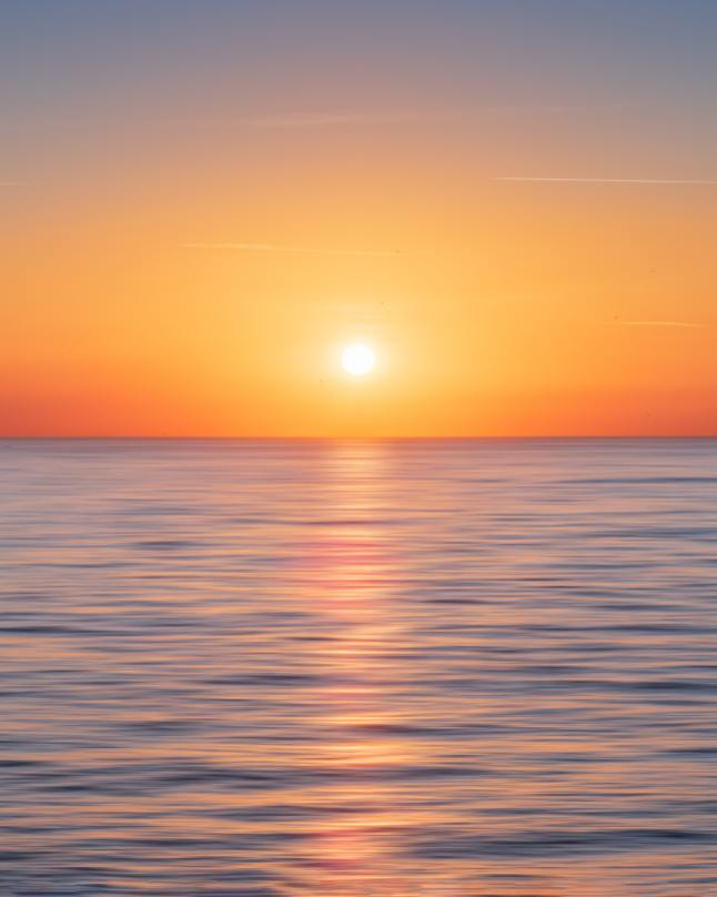 water-with-sun-and-orange-sky
