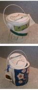 Capseta aprofitant un pot de pintura