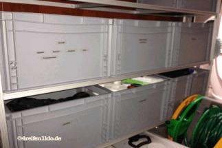 regalsystem-wohnmobil heckgarage-beschriftete kisten