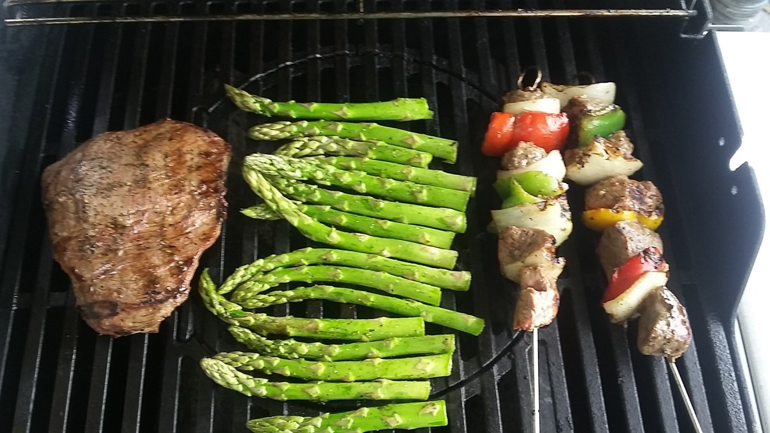 loaded grill flank steak asparagus and kabobs
